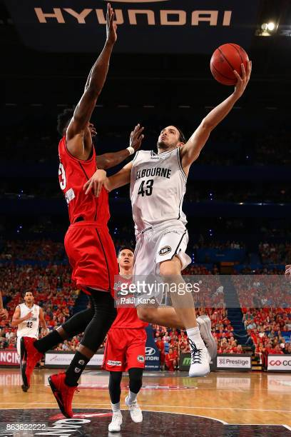 Chris Goulding of United lays up against Derek Cooke Jr. Of the Wildcats during the round three NBL match between the Perth Wildcats and Melbourne...