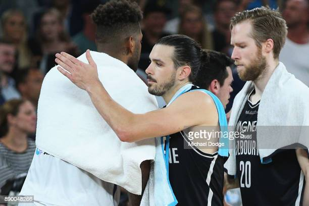 Chris Goulding of United makes up with Jeremy Tyler of the Kings after the round nine NBL match between Melbourne United and the Sydney Kings at...