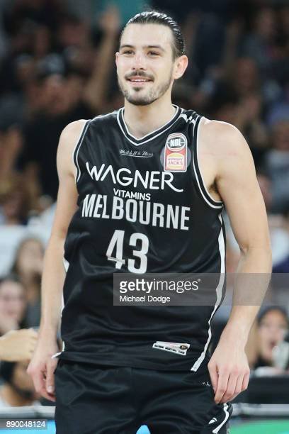 Chris Goulding of United reacts at Jeremy Tyler of the Kings after he makes a shot during the round nine NBL match between Melbourne United and the...