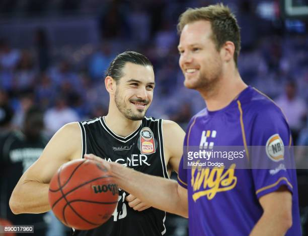 Chris Goulding of United reacts with Brad Newley of the Kings in the warm up during the round nine NBL match between Melbourne United and the Sydney...