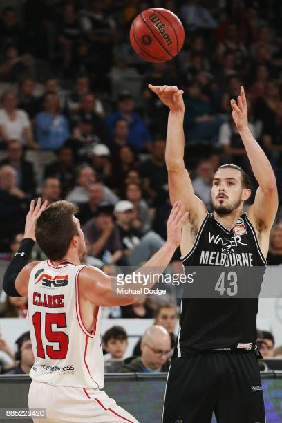 Chris Goulding of United shoots over Rotnei Clarke of the Hawks during the round eight NBL match between Melbourne United and the Illawarra Hawks at...