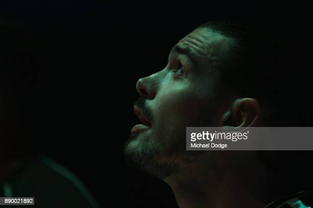 Chris Goulding of United stands in silence during the round nine NBL match between Melbourne United and the Sydney Kings at Hisense Arena on December...