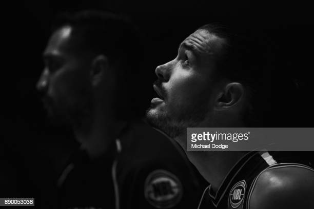 Chris Goulding of United stands in silence to pay tribute to former player Blair Smith who passes way during the round nine NBL match between...