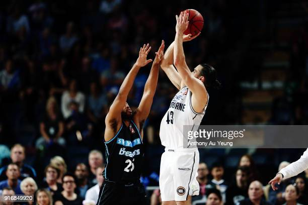 Chris Goulding of United takes a three pointer over Devonte DJ Newbill of the Breakers during the round 18 NBL match between the New Zealand Breakers...