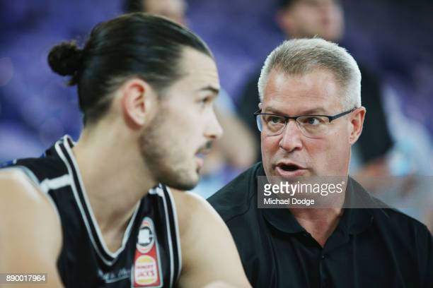 Chris Goulding of Unitedlistens to coach Dean Vickerman in the warm up during the round nine NBL match between Melbourne United and the Sydney Kings...