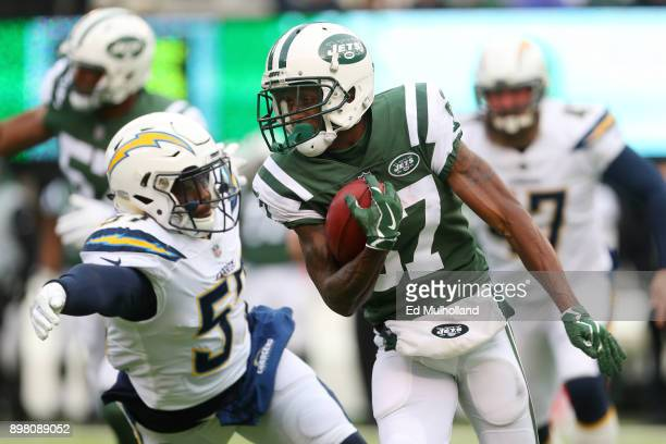 Chris Gragg of the New York Jets attempts to avoid the tackle of Jatavis Brown of the Los Angeles Chargers during the first half of an NFL game at...