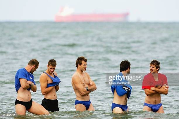 Chris Grant Tim Walsh Luke Darcy Kieran McGuinness and Adam Morgan wade through the water during the Western Bulldogs AFL recovery session at the...