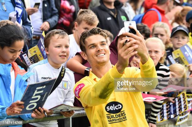 Chris Green of Birmingham Bears poses for a selfie with a fan during the Vitality Blast match between Birmingham Bears and Lancashire Lightning at...