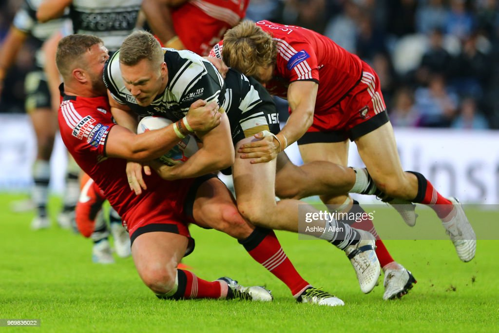 Chris Green of Hull FC is tackled during the Betfred Super League match between Hull FC and Salford Red Devils at KCOM Stadium on June 8, 2018 in Hull, England.