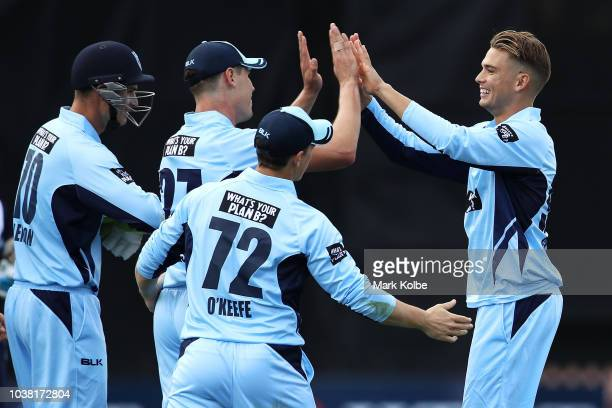 Chris Green of NSW celebrates with his team mates after taking the wicket of Peter Handscomb of Victoria during the JLT One Day Cup match between New...
