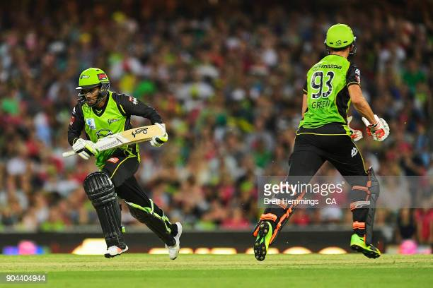 Chris Green of the Thunder and Arjun Nair of the Thunder run between the wicket during the Big Bash League match between the Sydney Sixers and the...