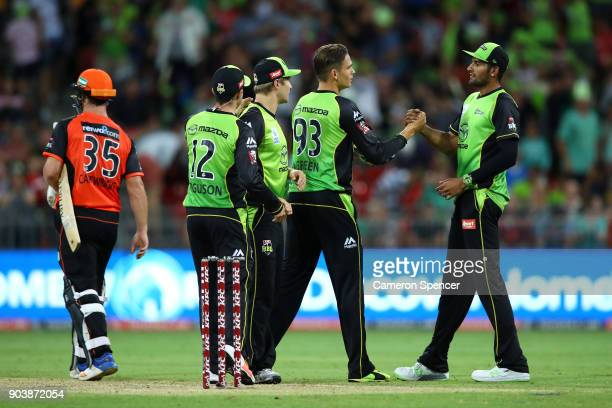 Chris Green of the Thunder and Gurinder Sandhu celebrate winning the Big Bash League match between the Sydney Thunder and the Perth Scorchers at...