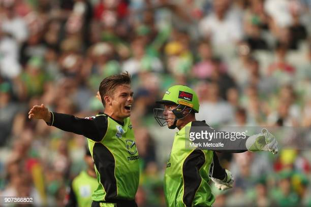 Chris Green of the Thunder and Jay Lenton of the Thunder celebrate taking the wicket of Kevin Pietersen of the Stars during the Big Bash League match...