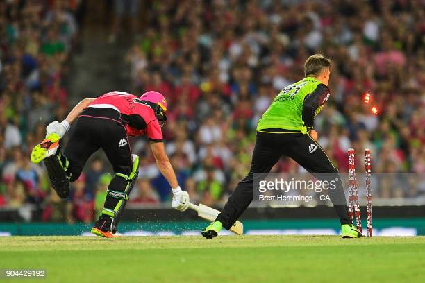 Chris Green of the Thunder attempts to run out Daniel Hughes of the Sixers during the Big Bash League match between the Sydney Sixers and the Sydney...