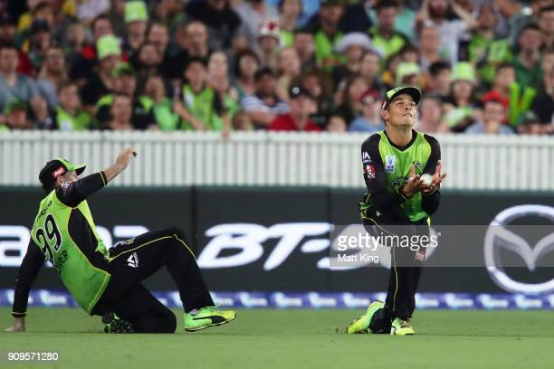 Chris Green of the Thunder avoids team mate Ben Rohrer and takes a catch to dismiss Marcus Harris of the Renegades during the Big Bash League match...