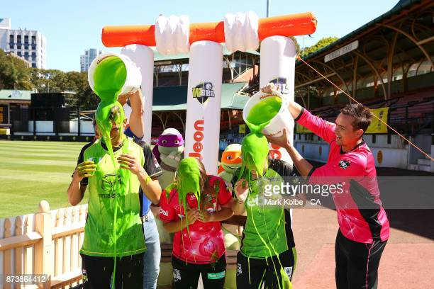 Chris Green of the Thunder Carly Leeson of the Sixer and Maisy Gibson of the Thunder are slimed by Lee Carseldine and Stephen O'Keefe of the Sixers...