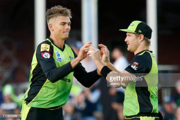 Chris Green of the Thunder celebrates a wicket with Shane Watson during the Big Bash League match between the Sydney Thunder and the Hobart...