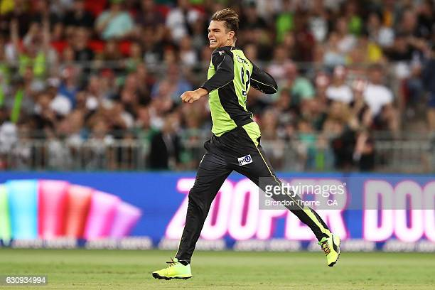 Chris Green of the Thunder celebrates after claiming the wicket of James Faulkner of the Stars during the Big Bash League match between the Sydney...