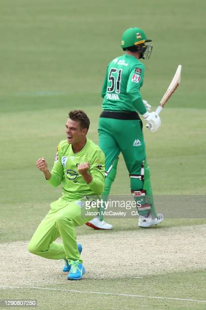 Chris Green of the Thunder celebrates after taking the wicket of Glenn Maxwell of the Stars during the Big Bash League match between the Melbourne...