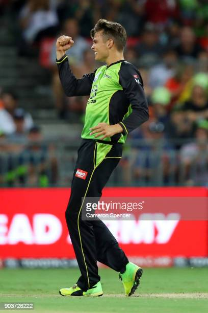 Chris Green of the Thunder celebrates after taking the wicket of Michael Klinger of the Scorchers during the Big Bash League match between the Sydney...