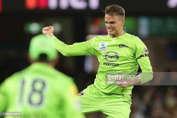 Chris Green of the Thunder celebrates taking the wicket of Dan Hughes of the Sixers during the Big Bash League match between the Sydney Sixers and...