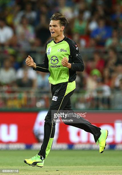 Chris Green of the Thunder celebrates taking the wicket of Joe Burns of the Heat during the Big Bash League match between the Sydney Thunder and...