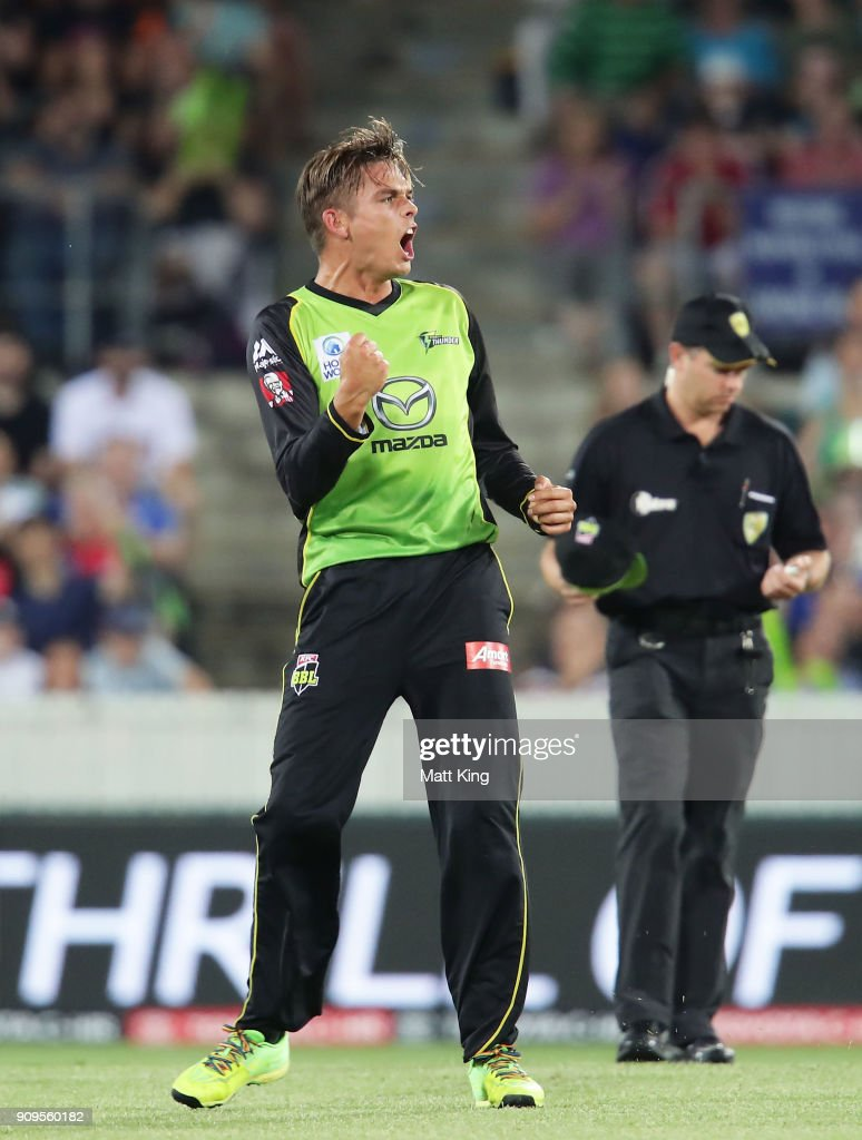 Chris Green of the Thunder celebrates taking the wicket of Marcus Harris of the Renegades during the Big Bash League match between the Sydney Thunder and the Melbourne Renegades at Manuka Oval on January 24, 2018 in Canberra, Australia.