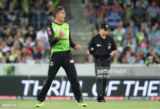 Chris Green of the Thunder celebrates taking the wicket of Marcus Harris of the Renegades during the Big Bash League match between the Sydney Thunder...