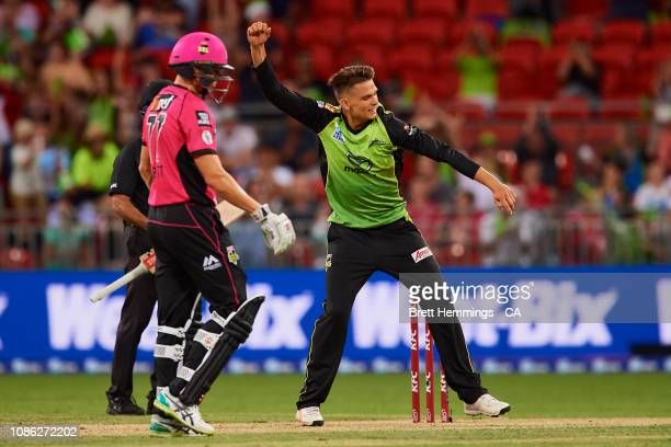 Chris Green of the Thunder celebrates taking the wicket of Tom Curran of the Sixers during the Sydney Thunder v Sydney Sixers Big Bash League Match...
