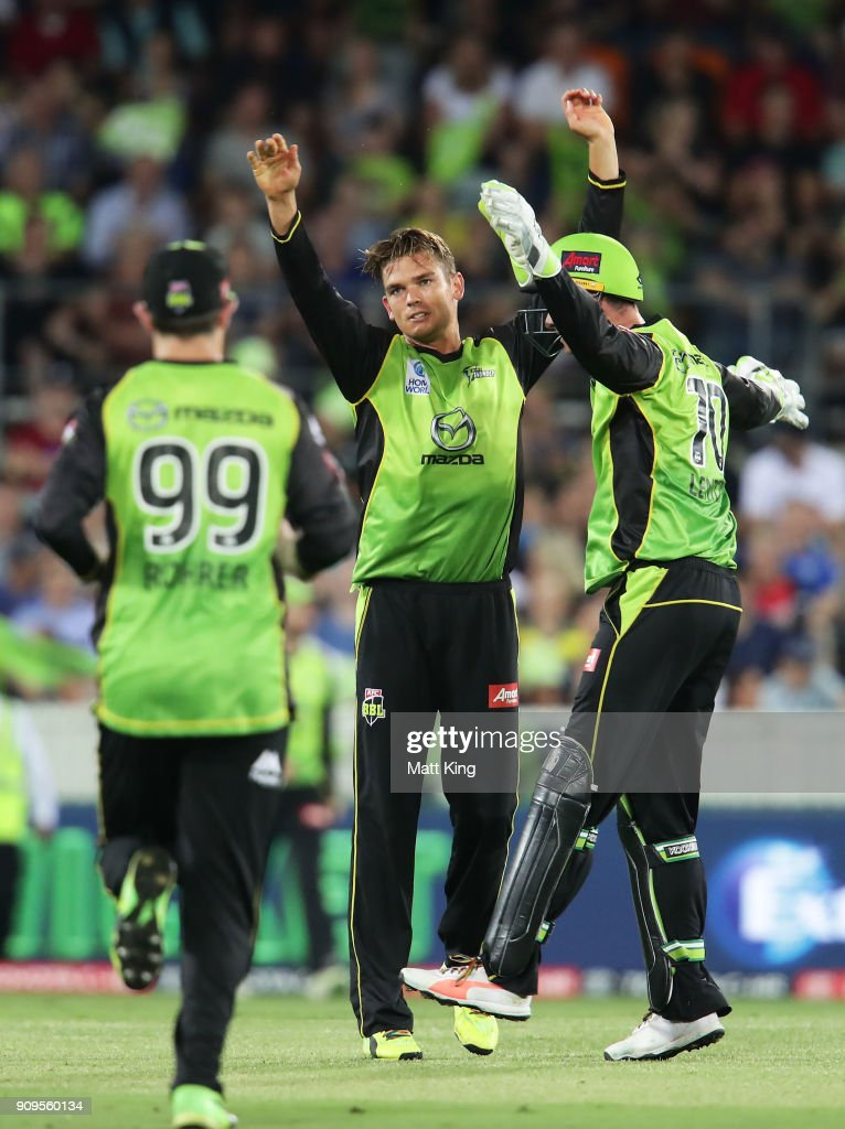 Chris Green of the Thunder celebrates with team mates after taking the wicket of Marcus Harris of the Renegades during the Big Bash League match between the Sydney Thunder and the Melbourne Renegades at Manuka Oval on January 24, 2018 in Canberra, Australia.