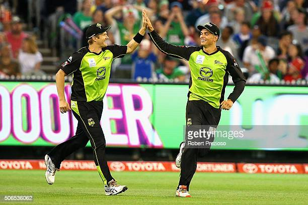 Chris Green of the Thunder celebrates with teammate Shane Watson of the Thunder after taking a catch to dismiss Evan Gulbis of the Stars off the...