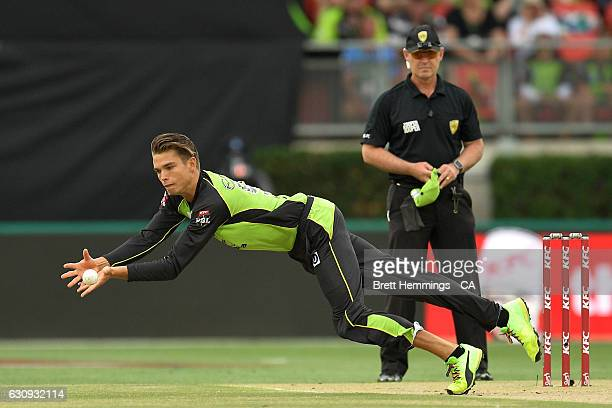 Chris Green of the Thunder dives to field the ball during the Big Bash League match between the Sydney Thunder and Melbourne Stars at Spotless...