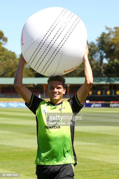 Chris Green of the Thunder holds a giant cricket ball during the KFC BBL Renewal Partnership with Nickelodeon for BBL|07 announcement at North Sydney...