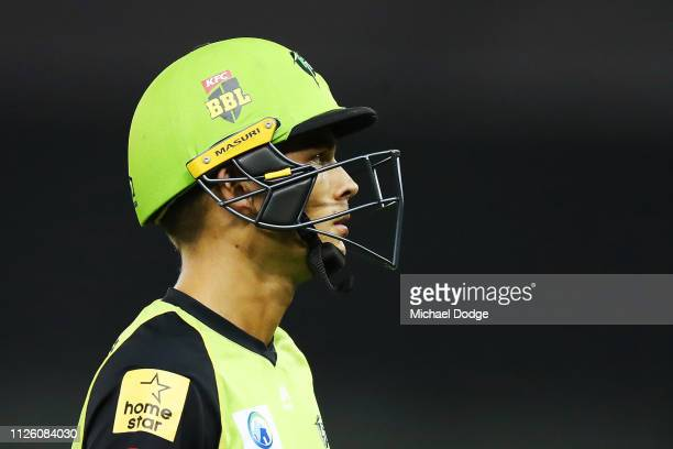 Chris Green of the Thunder looks dejected after being run out during the Big Bash League match between the Melbourne Renegades and Sydney Thunder at...