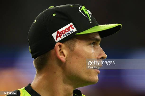 Chris Green of the Thunder looks on while fielding during the Big Bash League match between the Perth Scorchers and the Sydney Thunder at Optus...
