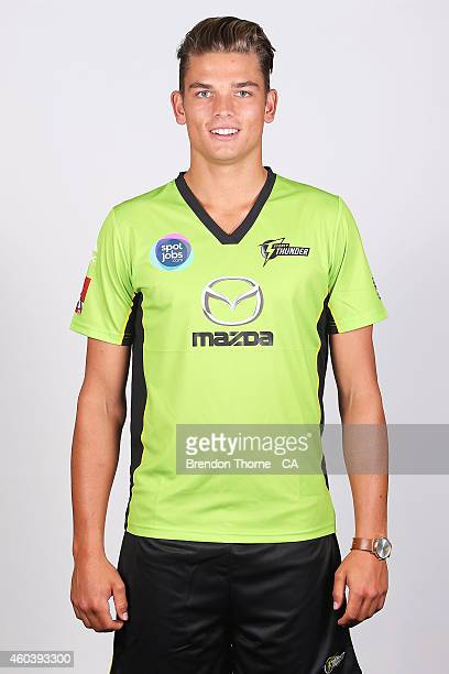 Chris Green of the Thunder poses during a Sydney Thunder Big Bash League headshots session at Sydney Olympic Park Sports Centre on December 13 2014...