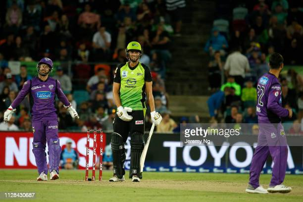 Chris Green of the Thunder reacts to a delivery by Qais Ahmad of the Hurricanes during the Big Bash League match between the Sydney Thunder and the...