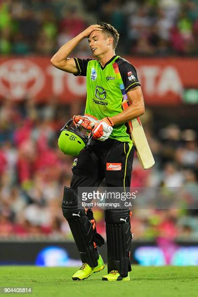 Chris Green of the Thunder shows his dejection after being run out by Peter Nevill of the Sixers during the Big Bash League match between the Sydney...