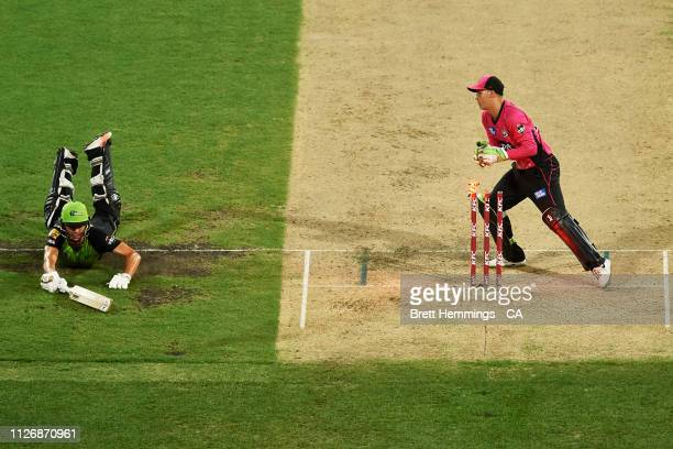 Chris Green of the Thunder slides into his crease to avoid being run out during the Big Bash League match between the Sydney Sixers and the Sydney...