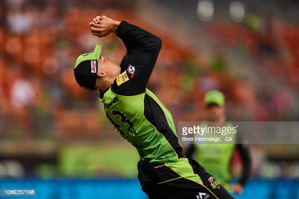Chris Green of the Thunder takes a catch to dismiss Moises Henriques of the Sixers during the Sydney Thunder v Sydney Sixers Big Bash League Match at...
