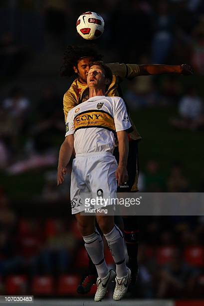 Chris Greenacre of the Phoenix heads the ball in front of Nikolai Topor-Stanley of the Jets during the round 15 A-League match between the Newcastle...