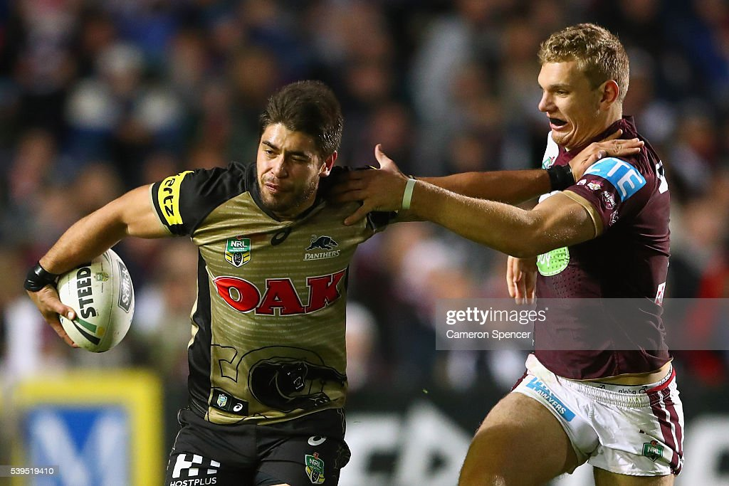 Chris Grevsmuhl of the Panthers fends off Tom Trbojevic of the Sea Eagles during the round 14 NRL match between the Manly Sea Eagles and the Penrith Panthers at Brookvale Oval on June 12, 2016 in Sydney, Australia.