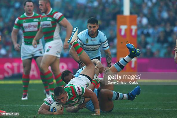 Chris Grevsmuhl of the Rabbitohs is tackled by the Shark's Sam Tagataese during the Elimination Final match between South Sydney Rabbitohs and...