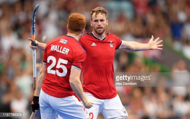 Chris Griffiths of Great Britain celebrates scoring with teammate Jack Waller during the Men's FIH Field Hockey Pro League match between Great...