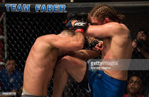 Chris Gruetzemacher knees Artem Lobov during the filming of The Ultimate Fighter Team McGregor vs Team Faber at the UFC TUF Gym on August 18 2015 in...