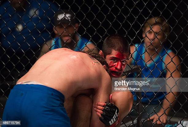 Chris Gruetzemacher pushes Sascha Sharma up against the cage during the filming of The Ultimate Fighter: Team McGregor vs Team Faber at the UFC TUF...