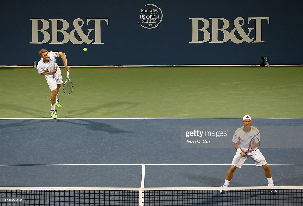 Chris Guccione and Lleyton Hewitt, both of Australia, serve to Colin Fleming and Jonathan Marray, both of Great Britain, during the BB&T Atlanta Open in Atlantic Station on July 27, 2013 in Atlanta, Georgia.