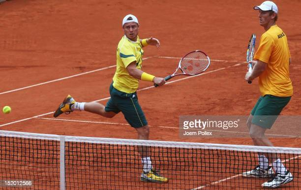 Chris Guccione and Lleyton Hewitt of Australia in action during their doubles match against Benjamin Becker and Philipp Petzschner of Germany during...