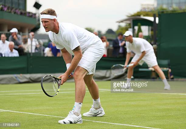 Chris Guccione and Samuel Groth of Australia wait to receive a serve during their Gentlemen's Doubles first round match against Steve Johnson of the...