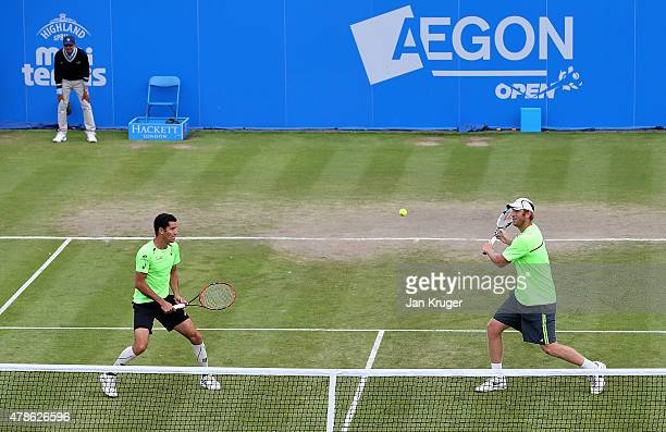 Chris Guccione of Australia and Andre Sa of Brazil in action against Colin Fleming of Great Britain and doubles partner Eric Butorac of USA during...